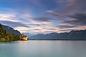 Chillon Castle (Chateau de Chillon) on shores of Lake Geneva at sunset, Veytaux, Montreux, Canton of Vaud, Switzerland