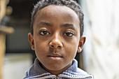 Portrait of sad looking boy, Berhale, Afar Region, Ethiopia, Africa