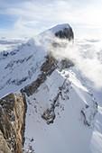 Aerial view of snow capped Punta Penia, west ridge and Forcella Marmolada, Dolomites, Trentino-Alto Adige, Italy