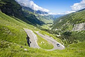 Car traveling on the hairping bends of Klausenpass mountain road, Canton Uri, Switzerland