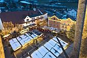 Elevated view of Christmas Markets and decorated tree at dusk, Vipiteno, Bolzano province, South Tyrol, Italy