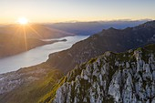 Sunset over Abbadia Lariana and Mandello Del Lario towns on shores of Lake Como, aerial view, Lecco province, Lombardy, Italy