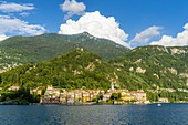 Varenna and surrounding mountains seen from ferry boat, Lake Como, Lecco province, Lombardy, Italy