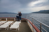 Couple on deck of cruise ship, near Opatija, Primorje-Gorski Kotar, Croatia, Europe