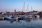 Fishing boats and sailing boats in the marina at dusk, Rab, Primorje-Gorski Kotar, Croatia, Europe