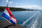 Croatian national flag on board the cruise ship, near Rab, Primorje-Gorski Kotar, Croatia, Europe