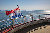 Croatian national flag on board the cruise ship, near Kukljica, Zadar, Croatia, Europe