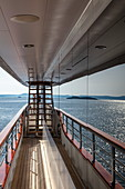 Islands are reflected in window of cruise ship, near Kukljica, Zadar, Croatia, Europe