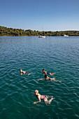 Passengers of the cruise ship swim in a pristine bay, near Kukljica, Zadar, Croatia, Europe