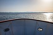 Bow of cruise ship at sunset, near Kukljica, Zadar, Croatia, Europe
