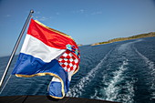 Croatian national flag on board the cruise ship, Kornati Islands National Park, Šibenik-Knin, Croatia, Europe