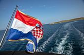 Croatian national flag on board the cruise ship, Kornati Islands National Park, Šibenik-Knin, Croatia, Europe