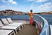 Woman stands on the railing of the cruise ship, Primosten, Šibenik-Knin, Croatia, Europe