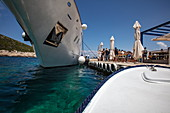 Front of excursion boat under the bow of cruise ship, near Vis, Vis, Split-Dalmatia, Croatia, Europe