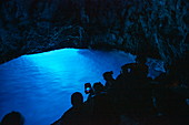 Excursion boat inside the Blue Cave on the island of Bisevo, near Vis, Vis, Split-Dalmatia, Croatia, Europe