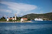 Church on peninsula and coast with ferry, Vis, Vis, Split-Dalmatia, Croatia, Europe