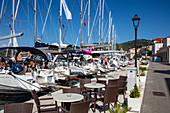 Sailboats and city seafront promenade with outdoor dining seating, Vis, Vis, Split-Dalmatia, Croatia, Europe