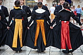 Folklore performance of a dance group in traditional costumes in the old town, Split, Split-Dalmatia, Croatia, Europe
