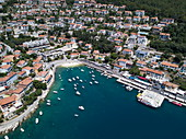 Aerial view of fishing boats and yachts in harbor in front of town, Rabac, Istria, Croatia, Europe