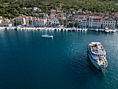 Aerial view of boats docked next to old town, Vis, Vis, Split-Dalmatia, Croatia, Europe