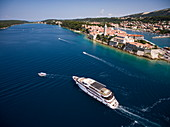 Aerial view of cruise ship MS Romantic Star with town behind, near Rabac, Istria, Croatia, Europe