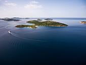 Aerial view of cruise ship in the Adriatic Sea with islands behind, Kornati Islands National Park, Šibenik-Knin, Croatia, Europe