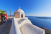 Orthodox church overlooking Santorini caldera, Thira, Santorini, Cyclades Islands, Greece