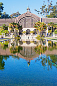 Botanical building viewed across Lily Pond, San Diego, California, USA