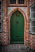 Old green door in Lueneburg, Germany