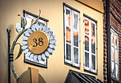 Shop sign in the form of a flower in the old town of Lueneburg, Germany