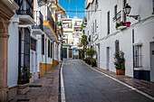 Typical small street in the old town of Marbella, Spain
