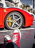 Ferrari and red sneakers in Puerto Banus, Marbella, Spain