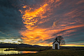 The chapel on the Riegsee in front of a dramatic evening sky, Aidling, Murnau, Bavaria, Germany
