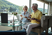 Couple enjoying afternoon coffee in the Panorama Lounge on board the river cruise ship during a cruise on the Rhine, Goarshausen Wellmich, Rhineland-Palatinate, Germany, Europe