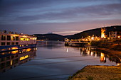 River cruise ship at the pier during a cruise on the Rhine at dusk, Ruedesheim am Rhein, Hesse, Germany, Europe