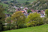 View over village in spring, Habichsthal, near Frammersbach, Spessart-Mainland, Franconia, Bavaria, Germany, Europe