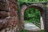 Wooden bridge over moat and stone gate of the Wildenstein castle ruins, Eschau Wildenstein, Räuberland, Spessart-Mainland, Franconia, Bavaria, Germany, Europe