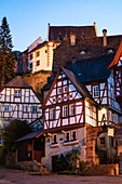 Half-timbered houses at the historic Schnatterloch market square with Mildenburg Castle at dusk, Miltenberg, Spessart-Mainland, Franconia, Bavaria, Germany, Europe