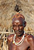 Ethiopia; Southern Nations Region; southern Ethiopian highlands; Hamer village near Turmi; Hamer man; Village elder; Head of the family