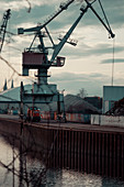 Port facility in Regenburg with a train and cranes in the background, Regensburg, Germany