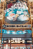 Aufwendige Leuchtreklame in Osaka mit den Maskotchen der Supermärkte von Don Quijote, Osaka, Japan