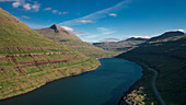 Fjord at Funningsfjørður on Eysturoy in the daytime with sunshine, Faroe Islands