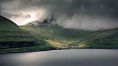 Funningur Municipality on Eysturoy Island under dramatic clouds, Faroe Islands