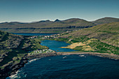The campsite of Eidi on Eysturoy with the village in the background, Faroe Islands
