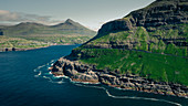 Streymoy Island and Eysturoy during the day with sun and blue sky, Faroe Islands