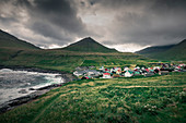 Village of Gjogv on Eysteroy with sea and mountains, Faroe Islands