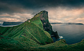 Kalsoy lighthouse with steep cliffs, Faroe Islands