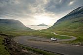 Campervan on the winding road to Norðradalur on Streymoy, Faroe Islands