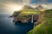 Múlafossur waterfall with Gásadalur village on Vagar island, Faroe Islands