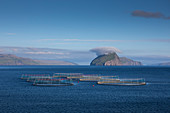 Fish farm off Koltur Island in the sun, Faroe Islands